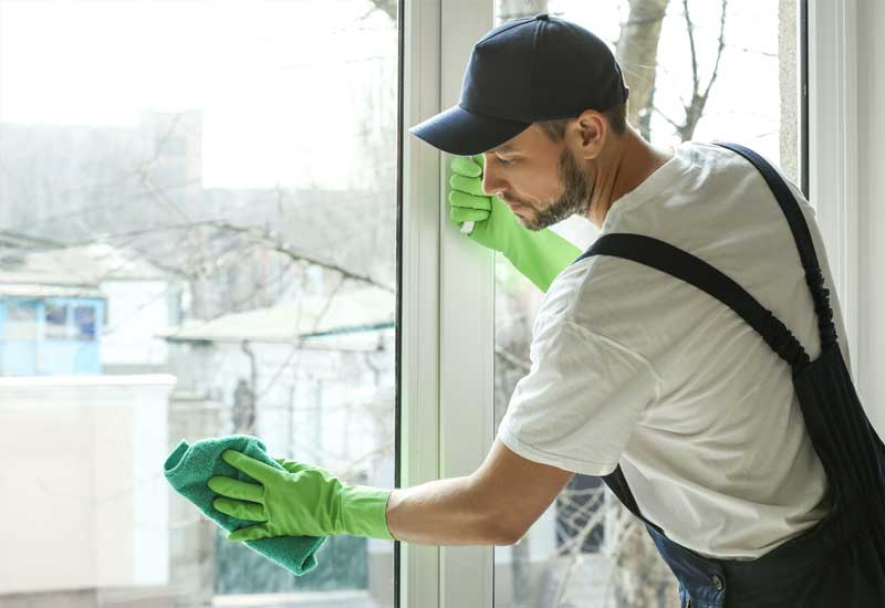 cleaner-cleaning-window