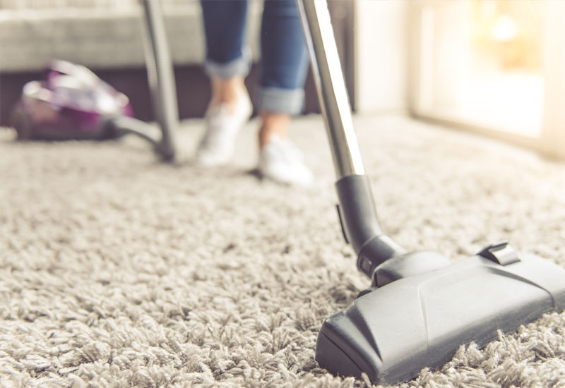 home-cleaner-cleaning-carpets