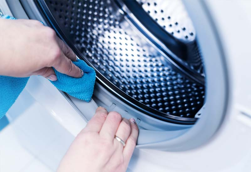 cleaning-washing-machin-in-laundry
